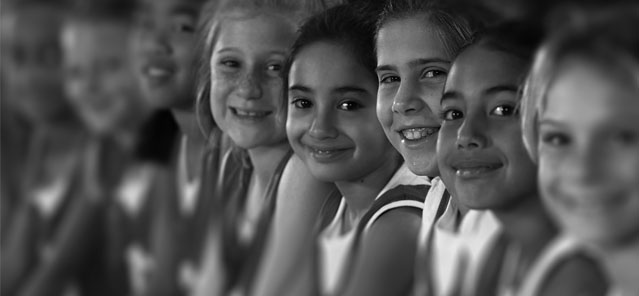 Black and White Image of Young Athletes Smiling